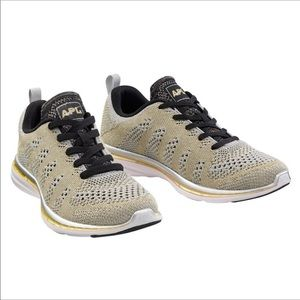 APL Athletic Propulsion Labs gold & black sneakers